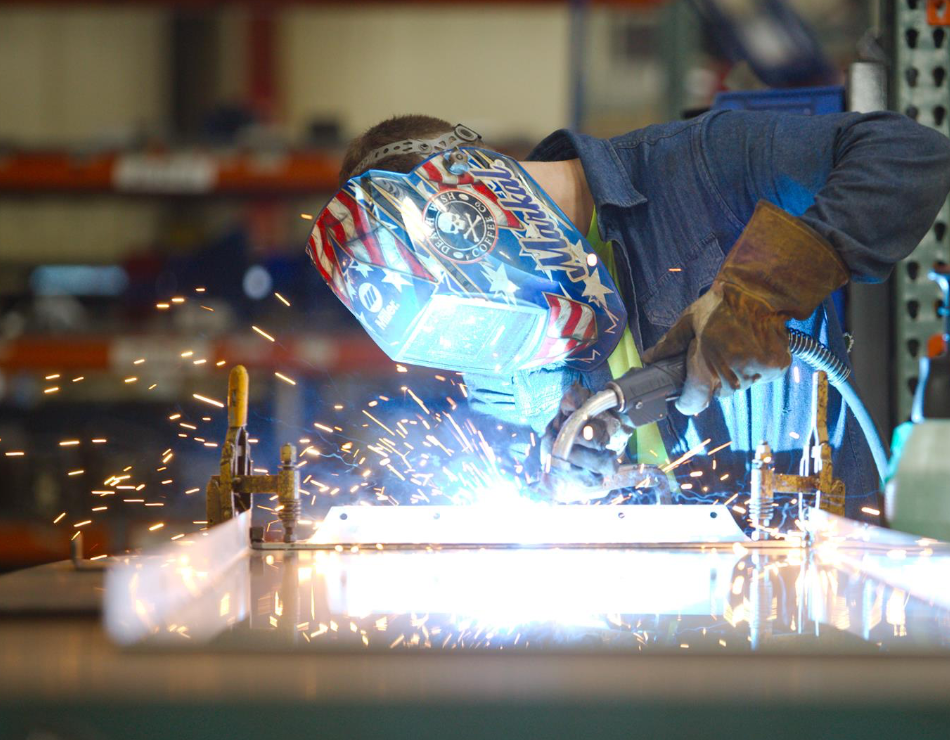 Man welding with a helmet on