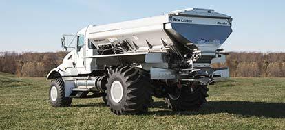 Spreader truck in field
