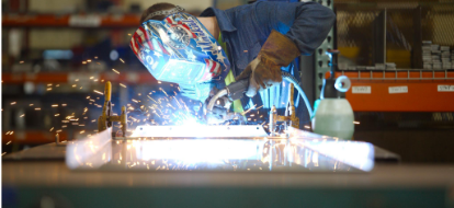 Man welding with helmet on