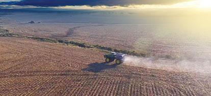 Tractor Spreading Fertilizer on Farm